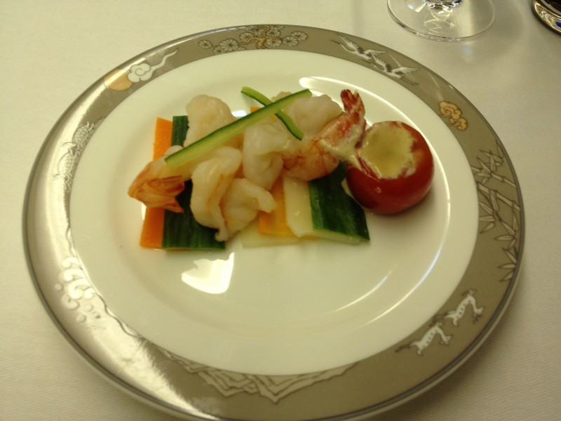 Shrimp with pine nut dressing.