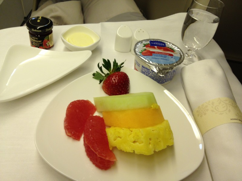 Fruit plate and strawberry yogurt.