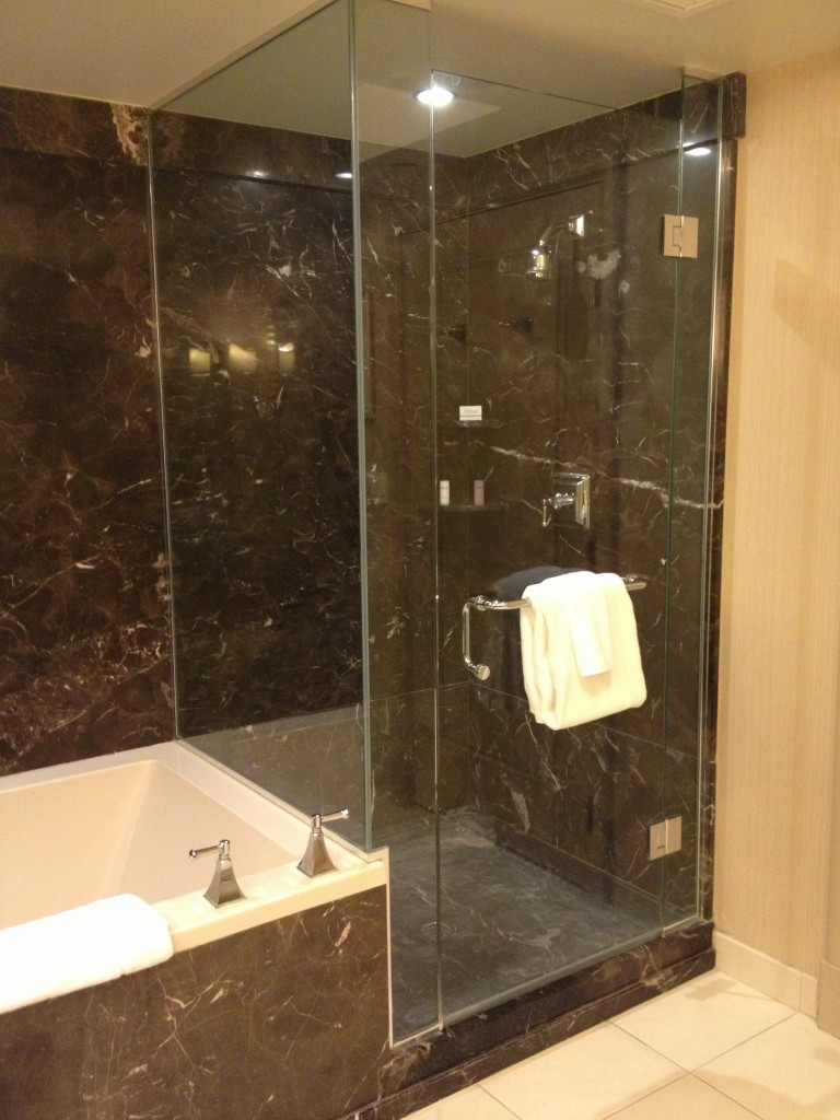 Separate tub and shower, and as you can see there's lots of marble.