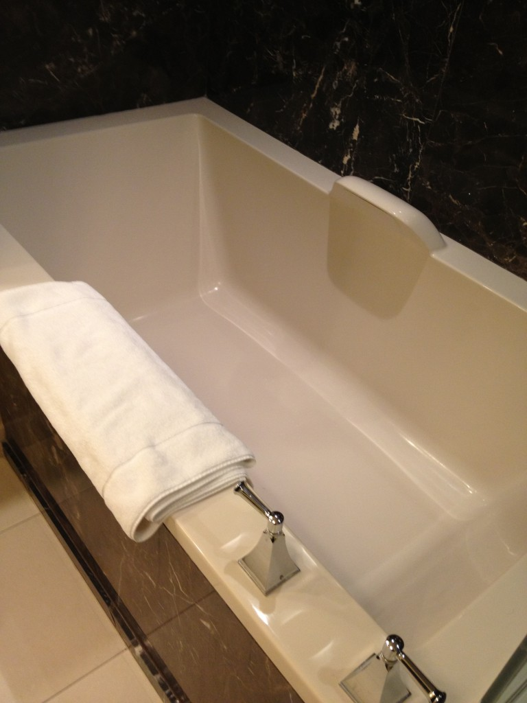 The separate tub was partially tucked in the corner. Too bad there were no jets!